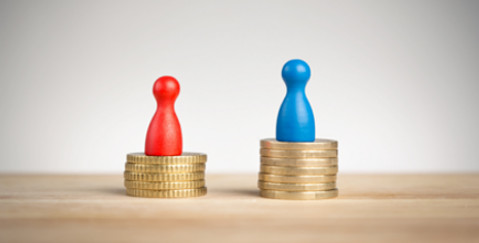 Gender Pay Gap FAQ - man on a taller stack of coins