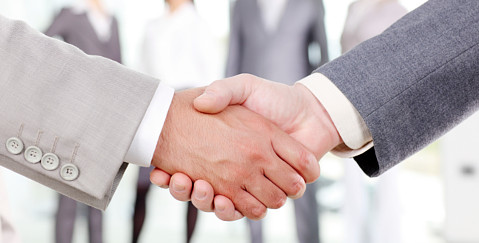 Setttlement Agreement Lawyers - business people shaking hands