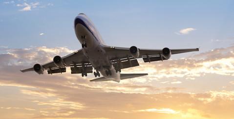 Aerospace lawyers - Plane taking off into sunset image